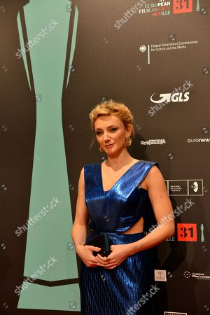 Actress Alexandra Borbely poses on the red carpet during the European Film Awards in Seville, Spain, on