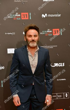 Spanish actor Fernando Tejero poses on the red carpet during the European Film Awards in Seville, Spain, on