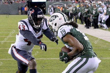 Stock Image of New York Jets wide receiver Andre Roberts (19) catches a touchdown pass from quarterback Sam Darnold, not pictured, as Houston Texans defensive back Shareece Wright (43) defends during the second half of an NFL football game, in East Rutherford, N.J
