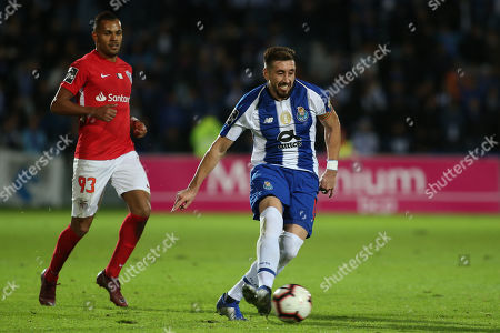 Stock Image of Santa Clara's player Fernando (L) in action against FC Porto's player Hector Herrera (R) during their Portuguese First League soccer match held at Sao Miguel stadium in Ponta Delgada, at Sao Miguel island, Azores, Portugal, 15 December 2018.