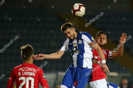 Santa Clara's player Osama Rashid (R) in action against FC Porto's player Hector Herrera (C) during their Portuguese First League soccer match held at Sao Miguel stadium in Ponta Delgada, at Sao Miguel island, Azores, Portugal, 15 December 2018.