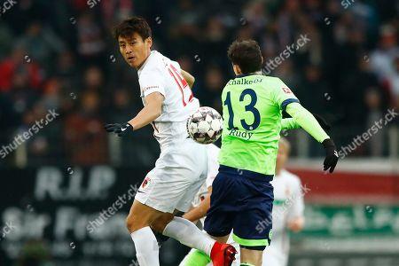 Augsburg's Ja-Cheol Koo, left, and Schalke's Sebastian Rudy challenge for the ball during the German Bundesliga soccer match between FC Augsburg and FC Schalke 04 in Augsburg, Germany