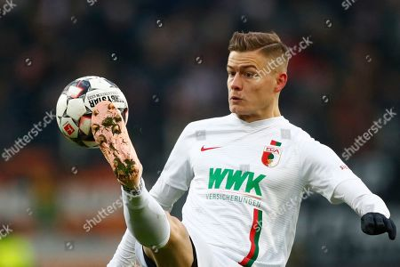 Augsburg's Alfred Finnbogason controls the ball during the German Bundesliga soccer match between FC Augsburg and FC Schalke 04 in Augsburg, Germany