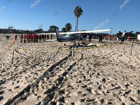 In this photo released by the Orange County Fire Authority, (OCFA), a small Cessna airplane that touched down on Doheny State Beach rests on the sand, in Dana Point, Calif. The small-engine plane made an emergency landing on the Southern California beach but no one aboard or on the ground was hurt. The pilot told authorities he took off from John Wayne Airport and was on a leisurely flight when the plane lost power