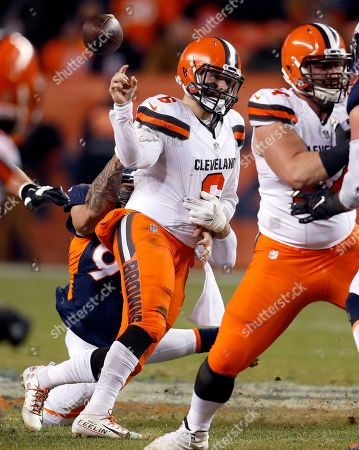 Denver Broncos defensive end Adam Gotsis, rear, forces Cleveland Browns quarterback Baker Mayfield (6) to fumble the football during the second half of an NFL football game, in Denver. The Broncos recovered the ball