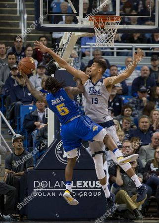 Nevada forward Trey Porter (15) blocks the shot of South Dakota State guard David Jenkins (5) in the first half of an NCAA college basketball game in Reno, Nev