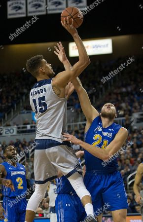 Nevada forward Trey Porter (15) shoots over South Dakota forward Mike Daum (24) State in the first half of an NCAA college basketball game in Reno, Nev