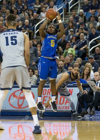 South Dakota State guard David Jenkins (5) shoots against Nevada in the second half of an NCAA college basketball game in Reno, Nev