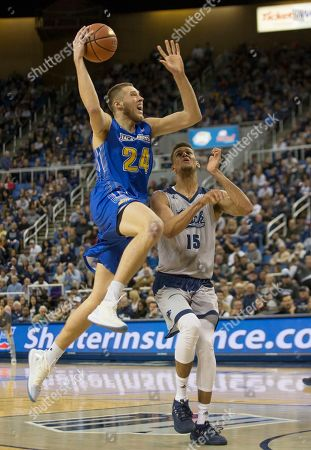 South Dakota State forward Mike Daum takes a jump shot against Nevada in the second half of an NCAA college basketball game in Reno, Nev