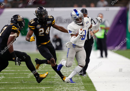 Middle Tennessee wide receiver Ty Lee (8) is chased out of bounds by Appalachian State linebacker Akeem Davis-Gaither (24) and defensive back Josh Thomas (7) in the first half of the New Orleans Bowl NCAA college football game in New Orleans