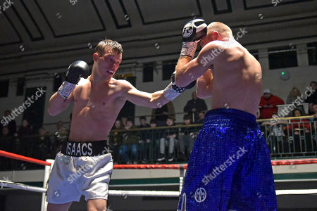 Louis Isaacs (white/black shorts) defeats Jamie Quinn during a Boxing Show at York Hall on 15th December 2018