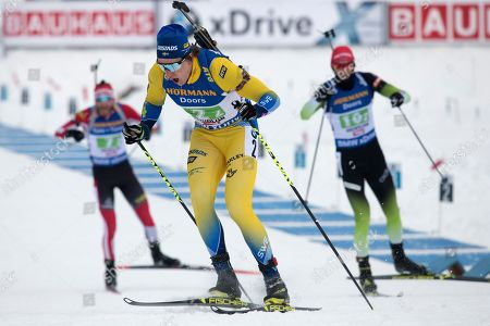 Martin Ponsiluoma of Sweden (front) leaves the shooting range ahead of Simon Eder of Austria (L back) and Jakov Fak of Slovenia (R back)  in the men's 4x7,5 km relay race at the IBU Biathlon World Cup in Hochfilzen, Austria, 16  December 2018.