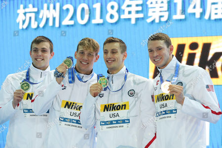 Gold medalists from USA, from left, Ryan Held, Caeleb Dressel, Andrew Wilson and Ryan Murphy pose during ceremonies for the men's 4x100m medley relay 14th FINA World Swimming Championships in Hangzhou in eastern China's Zhejiang Province on