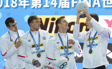 Gold medalists from USA, from left, Ryan Held, Caeleb Dressel, Andrew Wilson and Ryan Murphy gestures during ceremonies for the men's 4x100m medley relay 14th FINA World Swimming Championships in Hangzhou in eastern China's Zhejiang Province on