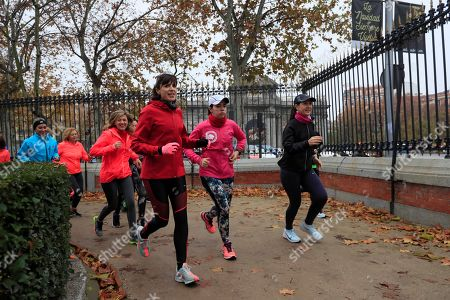 Stock Picture of Women run through the Retiro Park in Madrid, Spain, 16 December 2018, during the first gathering held to present the 'Sincronizadas' (synchronized), a new Internet platform that connects women nearby so they can run together and feel safer while practicing outdoors sports. According to a survey published by 'Runners World Magazine', nine out of 10 women don't feel safe while running outdoors on their own, this is why Cristina Mitre, founder of the Sincronizadas initiative, thought about creating a platform to allow women to meet so they could feel safe while running accompanied by other women.