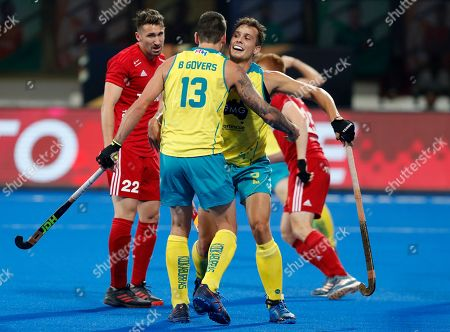 Australia's Tom Craig, right, celebrates with a teammate after scoring a goal during the Men's Hockey World Cup bronze medal match between Australia and England at Kalinga Stadium in Bhubaneswar, India