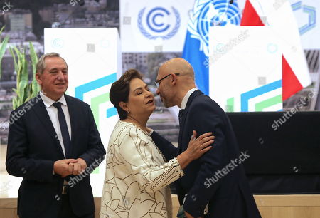UNFCCC (United Nations Framework Convention on Climate Change) executive secretary Patricia Espinosa (C), Poland's environment minister Henryk Kowalczyk (L) and president of COP24, deputy minister of environment Michal Kurtyka (R) during a press conference summing up the COP24 Climate Summit in Katowice, 16 December 2018. The COP (Conference of the Parties) summit is the highest body of the UN Framework Convention on Climate Change (UNFCC). Expected at the meeting are close to 30,000 delegates from all over the world, including government leaders and ministers responsible for environmental policy.