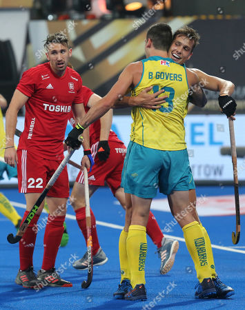 Australia's Blake Govers (2-R) hugs his team mate Tom Craig (R) as they celebrate a goal as England's David Condon (L) looks on during the Men's Field Hockey World Cup match between England and Australia at the Kalinga Stadium in Bhubaneswar, India, 16 December 2018.