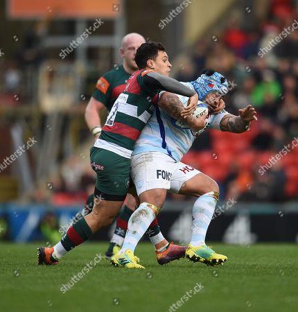 Matt Toomua of Leicester Tigers tackles Ole Avei of Racing 92.