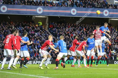 Rangers defender Gareth McAuley (36) heads the ball above a line of nine other players in a crowded penatly area during the Ladbrokes Scottish Premiership match between Rangers and Hamilton Academical FC at Ibrox, Glasgow