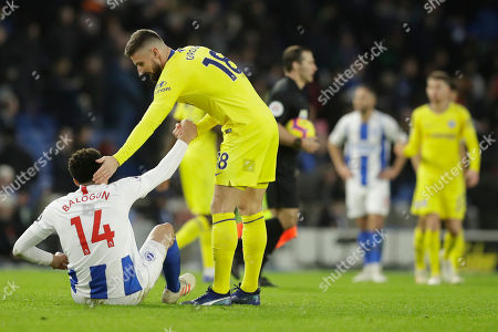 Chelsea's Olivier Giroud, right, greets Brighton's Leon Balogun at the end of the English Premier League soccer match between Brighton and Hove Albion and Chelsea at the Amex Stadium in Brighton, England, . Chelsea won 2-1