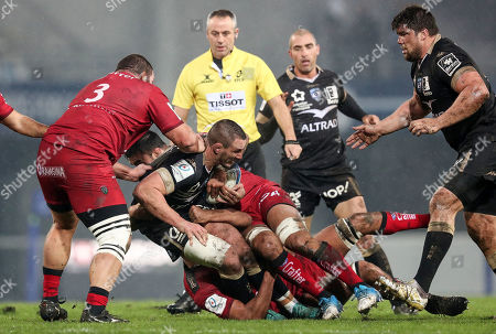 Montpellier vs RC Toulon. Montpellier's Louis Picamoles tackled by Swan Rebbadj and Liam Messam of Toulon