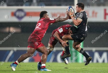 Montpellier vs RC Toulon. Montpellier's Arthur Vincent tackled by Liam Messam and Josua Tuisova of Toulon