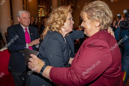 Stock Photo of Norway's Prime Minister Erna Solberg (R) greets Norwegian actress Liv Ullmann (L) during Ullmann's 80th birthday celebrations in Oslo, Norway, 16 December 2018.