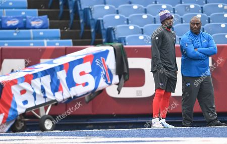 Buffalo Bills running back LeSean McCoy, left, talks with Detroit Lions running backs coach David Walker before an NFL football game, in Orchard Park, N.Y