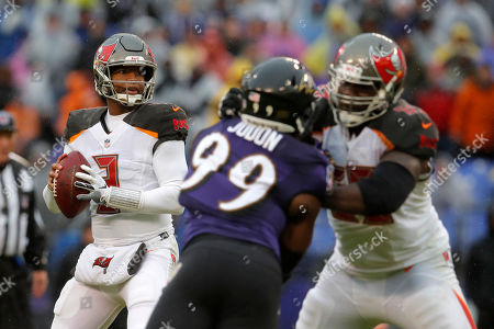 Week 13. Tampa Bay Buccaneers quarterback Jameis Winston, left, looks for a teammate as he is pressured by Baltimore Ravens outside linebacker Matt Judon (99) in the second half of an NFL football game, in Baltimore