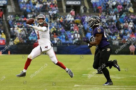 Week 13. Tampa Bay Buccaneers quarterback Jameis Winston, left, throws a pass as he is pressured by Baltimore Ravens outside linebacker Matt Judon in the first half of an NFL football game, in Baltimore