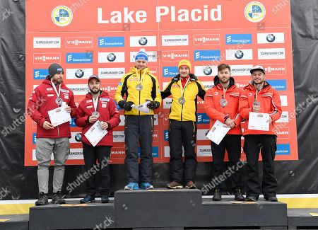 From left, Chris Mazdzer and Jayson Terdiman, of the United States, Toni Eggert and Sascha Benecken, of Germany, and Tristan Walker and Justin Snith, of Canada, celebrate after a Sprint World Cup luge event in Lake Placid, N.Y., on . Eggert and Benecken won gold, Mazdzer and Terdiman silver, and Walker and Snith bronze