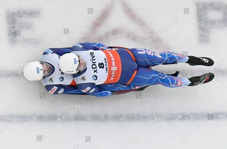 Chris Mazdzer and Jayson Terdiman, of the United States, compete in the luge sprint World Cup event, in Lake Placid, N.Y