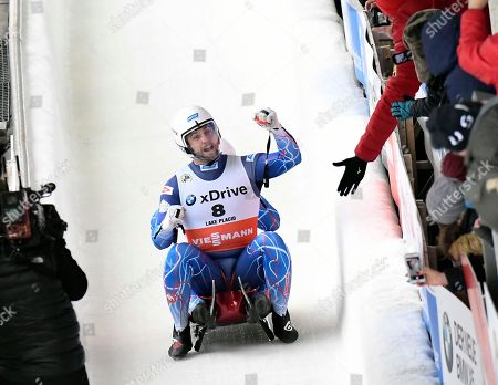 Chris Mazdzer and Jayson Terdiman, of the United States, react after competing in the luge sprint World Cup event, in Lake Placid, N.Y