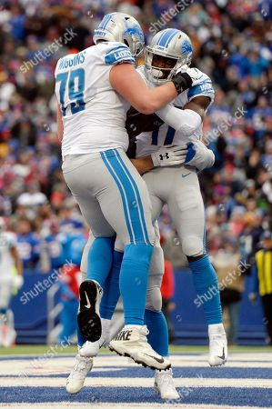 Detroit Lions wide receiver Andy Jones, right, celebrates with offensive guard Kenny Wiggins, left, after catching a 4-yard touchdown pass during the first half of an NFL football game against the Buffalo Bills, in Orchard Park, N.Y