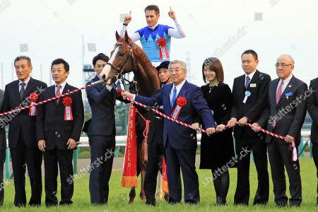, Winners presentation. Admire Mars with Mirco Demuro up wins the Asahi Hai Futurity Stakes at Hanshin racecourse.