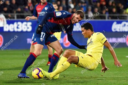Huesca's midfielder Christian Rivera (L) in action against Villarreal's forward Carlos Bacca (R) during the Spanish La Liga soccer match between SD Huesca and Villarreal CF in Huesca, Spain, 16 December 2018.