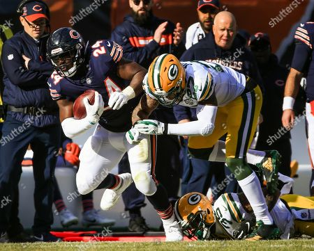 Chicago Bears running back Jordan Howard (L) is driven out of bounds by Green Bay Packers defensive back Josh Jones (R) during the NFL game between the Green Bay Packers and the Chicago Bears at Soldier Field in Chicago, Illinois, USA, 16 December 2018.