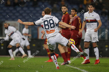 Genoa's Oscar Hiljemark, center, scores during the Italian Serie A soccer match between Roma and Genoa in Rome's Olympic stadium