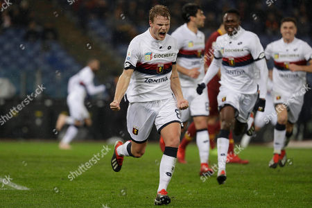 Genoa's Oscar Hiljemark, center, celebrates after scoring during the Italian Serie A soccer match between Roma and Genoa in Rome's Olympic stadium