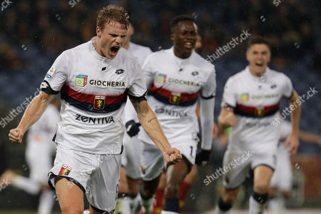 Stock Picture of Genoa's Oscar Hiljemark, left, celebrates after scoring during the Italian Serie A soccer match between Roma and Genoa in Rome's Olympic stadium