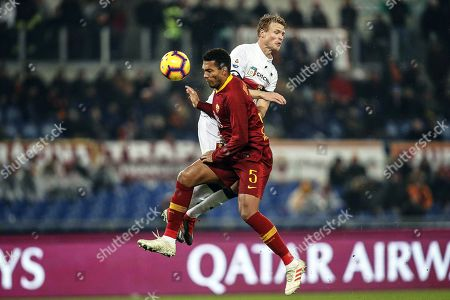 Stock Photo of Roma's Juan Jesus (L) in action against Genoa's Oscar Hiljemark (R) during the Italian Serie A soccer match between AS Roma and Genoa CFC in Rome, Italy, 16 December 2018.