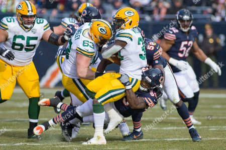 Chicago, Illinois, U.S. - Bears #59 Danny Trevathan tackles Packers #30 Jamaal Williams during the NFL Game between the Green Bay Packers and Chicago Bears at Soldier Field in Chicago, IL. Photographer: Mike Wulf