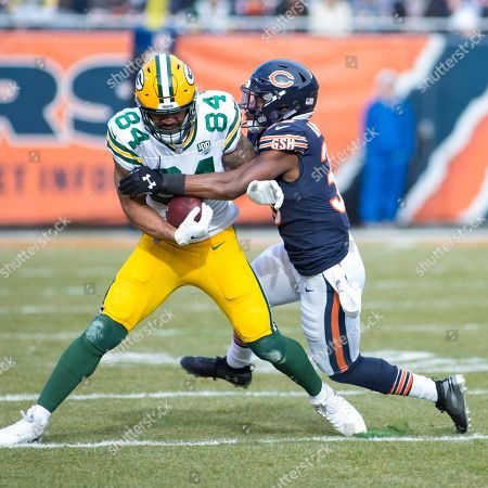 Chicago, Illinois, U.S. - Bears #38 Adrian Amos tackles Packers #84 Lance Kendricks during the NFL Game between the Green Bay Packers and Chicago Bears at Soldier Field in Chicago, IL. Photographer: Mike Wulf