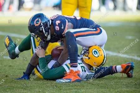 Chicago, Illinois, U.S. - Bears #94 Leonard Floyd sacks Packers Quarterback #12 Aaron Rodgers during the NFL Game between the Green Bay Packers and Chicago Bears at Soldier Field in Chicago, IL. Photographer: Mike Wulf