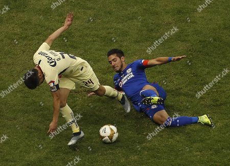 Javier Salas (R) of Cruz Azul in action against Oribe Peralta (L) of Club America during the Apertura Tournament finals second leg soccer match between Cruz Azul and Club America at the Azteca Stadium in Mexico City, Mexico, 16 December 2018.