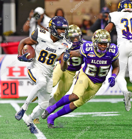 North Carolina A&T Malik Wilson 88 and Alcorn State Isiah Thomas 25 in action during the Air Force Celebration Bowl game between the North Carolina A&T Aggies and the Alcorn State Braves at the Mercedes Benz Dome in Atlanta Georgia