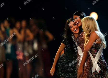 Miss Indonesia Sonia Fergina Citra (L), Miss Venezuela Sthefany Gutierrez (C) and Miss USA Sarah Rose Summers (R) react during the Miss Universe 2018 beauty pageant at Impact Arena in Bangkok, Thailand, 17 December 2018. Women representing 94 nations will participate in the 67th Miss Universe 2018 beauty pageant in Bangkok.