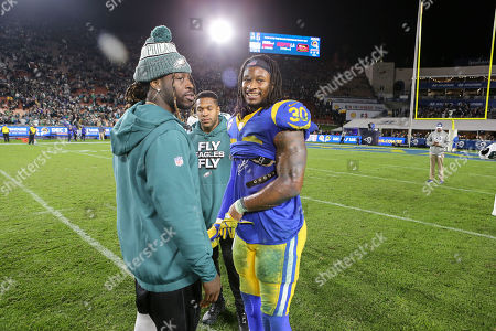 Los Angeles, CA...Philadelphia Eagles running back Jay Ajayi #26 chats with Los Angeles Rams running back Todd Gurley #30 after the NFL Philadelphia Eagles vs Los Angeles Rams at the Los Angeles Memorial Coliseum in Los Angeles, Ca on  2018. Jevone Moore