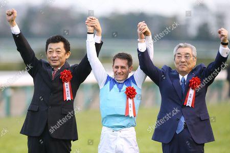 (L-R)  Yasuo Tomomichi,  Mirco Demuro,  Riichi Kondo - Horse Racing : Jockey Mirco Demuro celebrates with owner Riichi Kondo and trainer Yasuo Tomomichi after riding Admire Mars to win the Asahi Hai Futurity Stakes at Hanshin Racecourse in Hyogo, Japan.